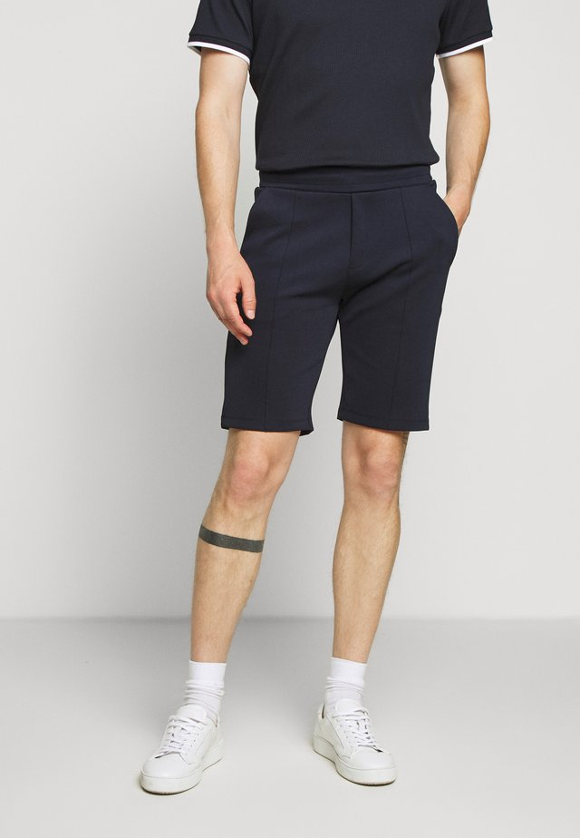 GASPARD - Tracksuit bottoms - marin