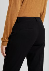 Sisley - TROUSERS - Pantaloni - black