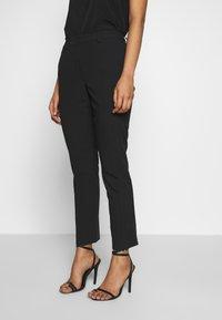 Sisley - TROUSERS - Pantaloni - black - 0