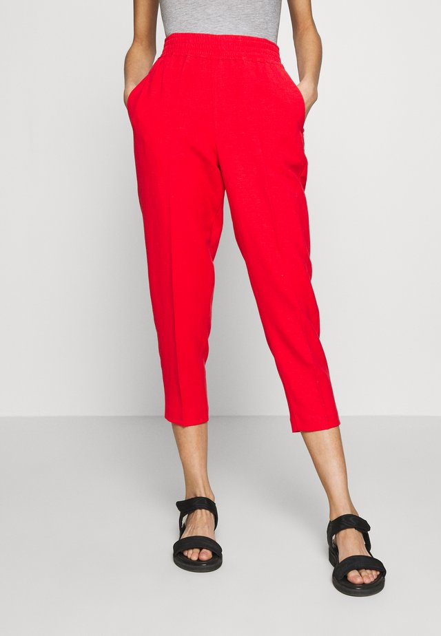 TROUSERS - Stoffhose - red