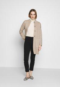 Sisley - TROUSERS - Jeans Skinny Fit - black - 1