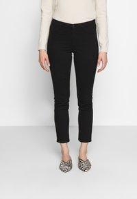 Sisley - TROUSERS - Jeans Skinny Fit - black - 0