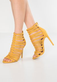 ALDO - RORKA - High heeled sandals - mustard - 0