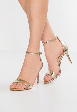 PILIRIA - Sandály na vysokém podpatku - gold