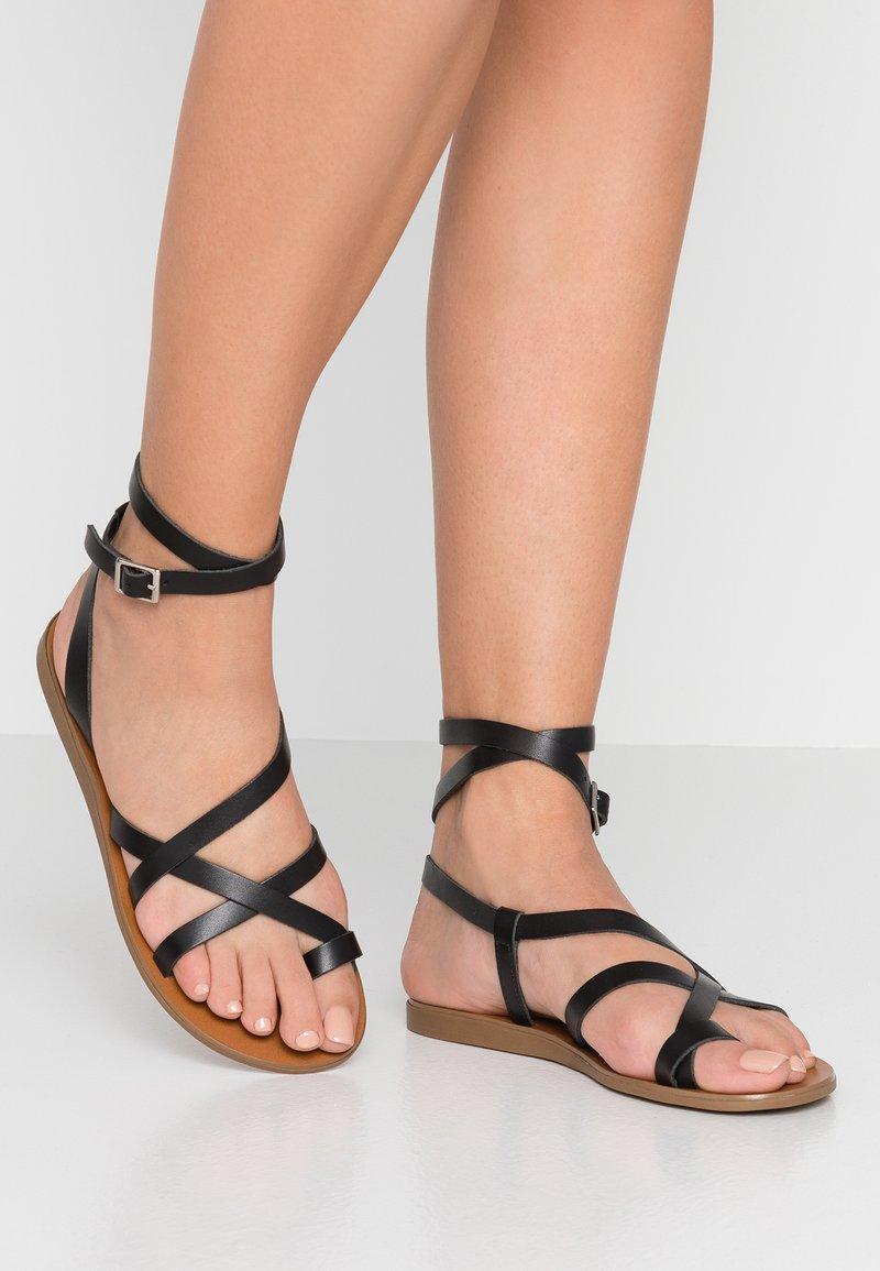ALDO - GLUDDA - T-bar sandals - black