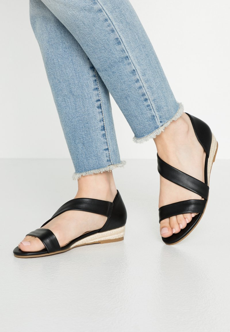 ALDO - MOEWEN - Wedge sandals - black