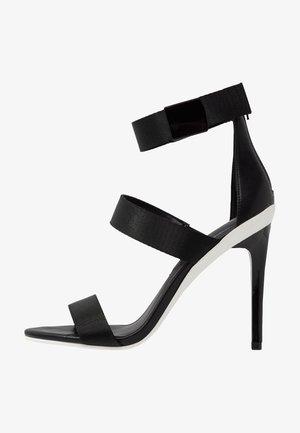 TRAESIEN - Korolliset sandaalit - black