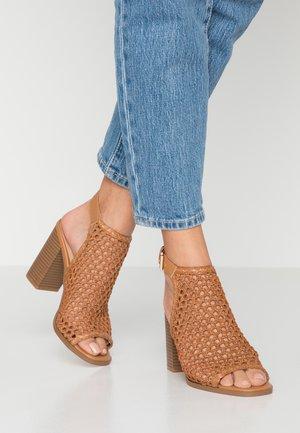 ELARADITH - High heeled sandals - cognac