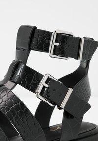 ALDO - GLASSY - Platform sandals - black - 2