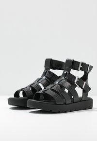 ALDO - GLASSY - Platform sandals - black - 4