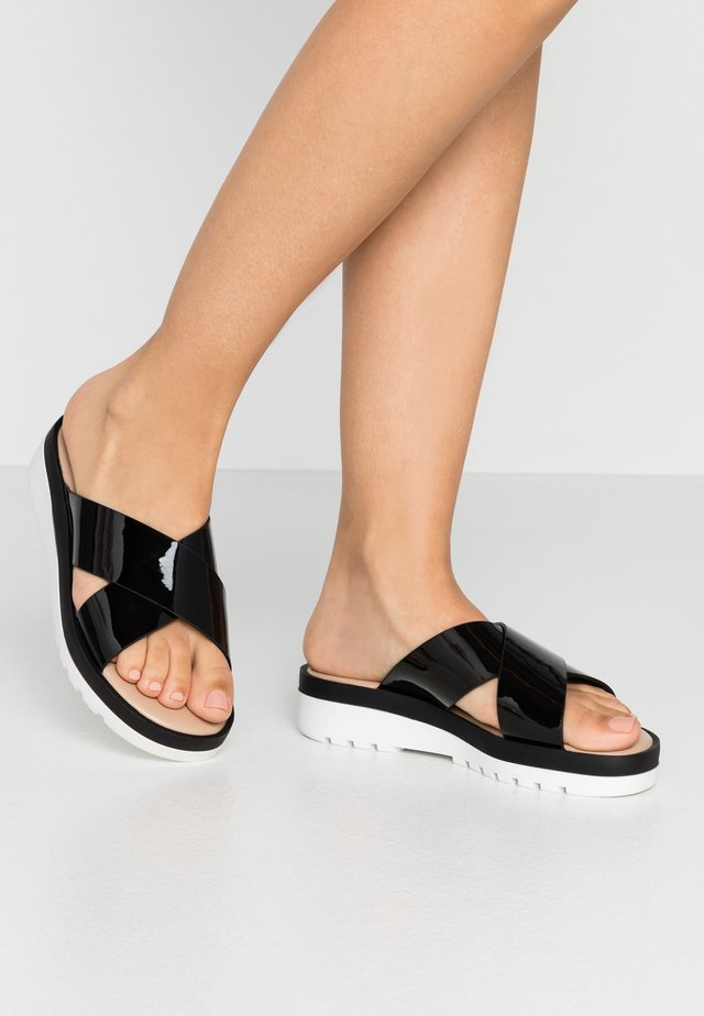 TOUATI - Pantolette flach - black