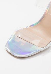 ALDO - ALDO x DISNEY - STEPSISTER - Pantofle na podpatku - clear - 2