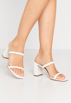 SEVADOSA - Pantolette hoch - white