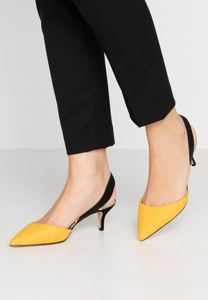 LOVORELLE - Classic heels - mustard