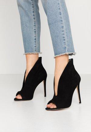 TININDRA - High heeled ankle boots - jet black