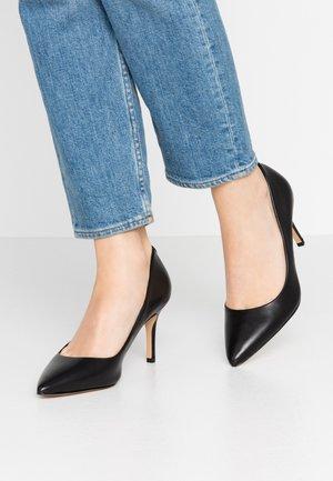CORONITI - Zapatos altos - black