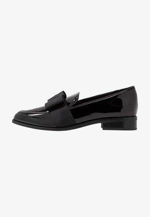 NERILLAN - Slip-ons - black