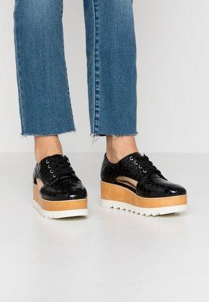 CURNERA - Šněrovací boty - black