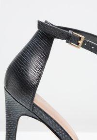 ALDO - CARAA - Sandaler med høye hæler - black - 5