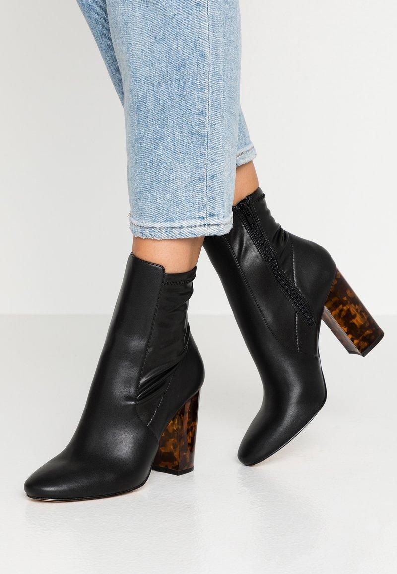 ALDO - AURELLA - High heeled ankle boots - black/multicolor