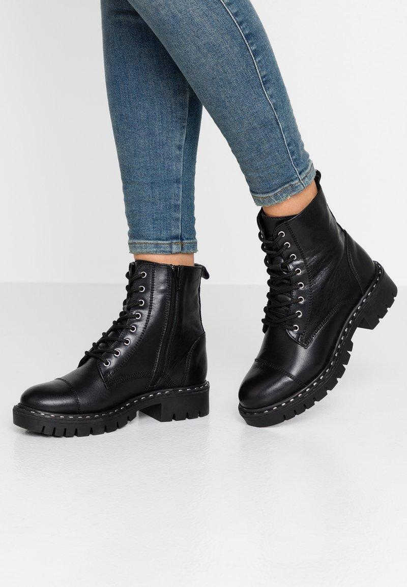 ALDO - GWEMMA - Platform ankle boots - black