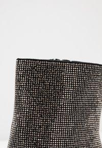ALDO - POSTMAWEI - Bottines à talons hauts - black/silver/multicolor - 2