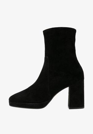 OLTINA - Platform ankle boots - black