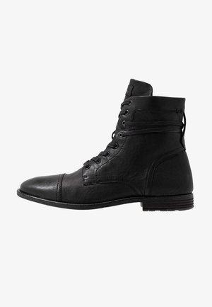 ADREIN - Šněrovací kotníkové boty - black