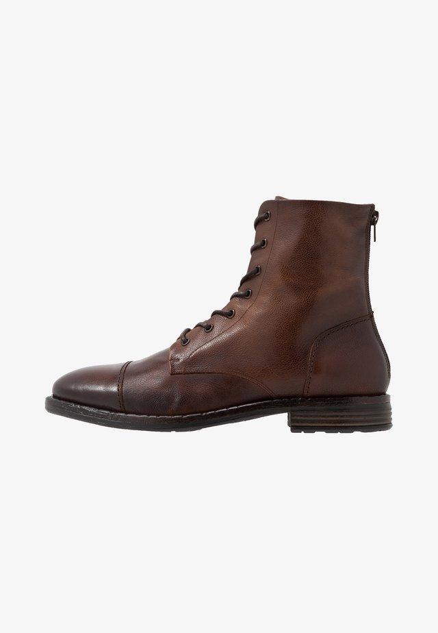 GURNARD - Lace-up ankle boots - cognac