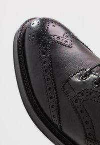 ALDO - VANELLUS - Šněrovací kotníkové boty - black - 5