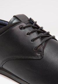 ALDO - AAUWEN - Volnočasové šněrovací boty - black - 5