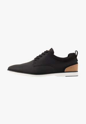 VOEDIEN - Volnočasové šněrovací boty - black