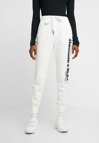 Abercrombie & Fitch - LONG LIFE - Tracksuit bottoms - white - 0