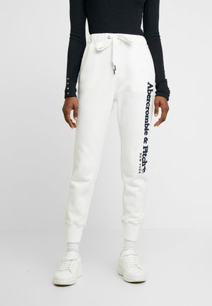 LONG LIFE - Tracksuit bottoms - white