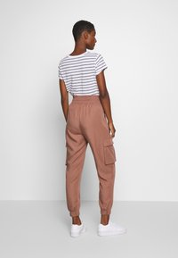 Abercrombie & Fitch - JOGGER - Trousers - brown - 2