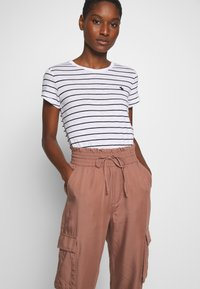 Abercrombie & Fitch - JOGGER - Trousers - brown - 3