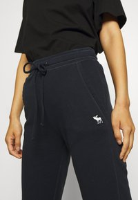 Abercrombie & Fitch - LOGO BANDED  - Tracksuit bottoms - navy - 3