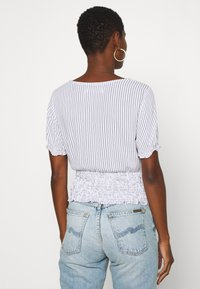 Abercrombie & Fitch - SMOCKED WRAP RUFFL - Blouse - blue/white - 2
