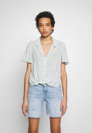 SIGNATURE TIE FRONT - Button-down blouse - mint grounded