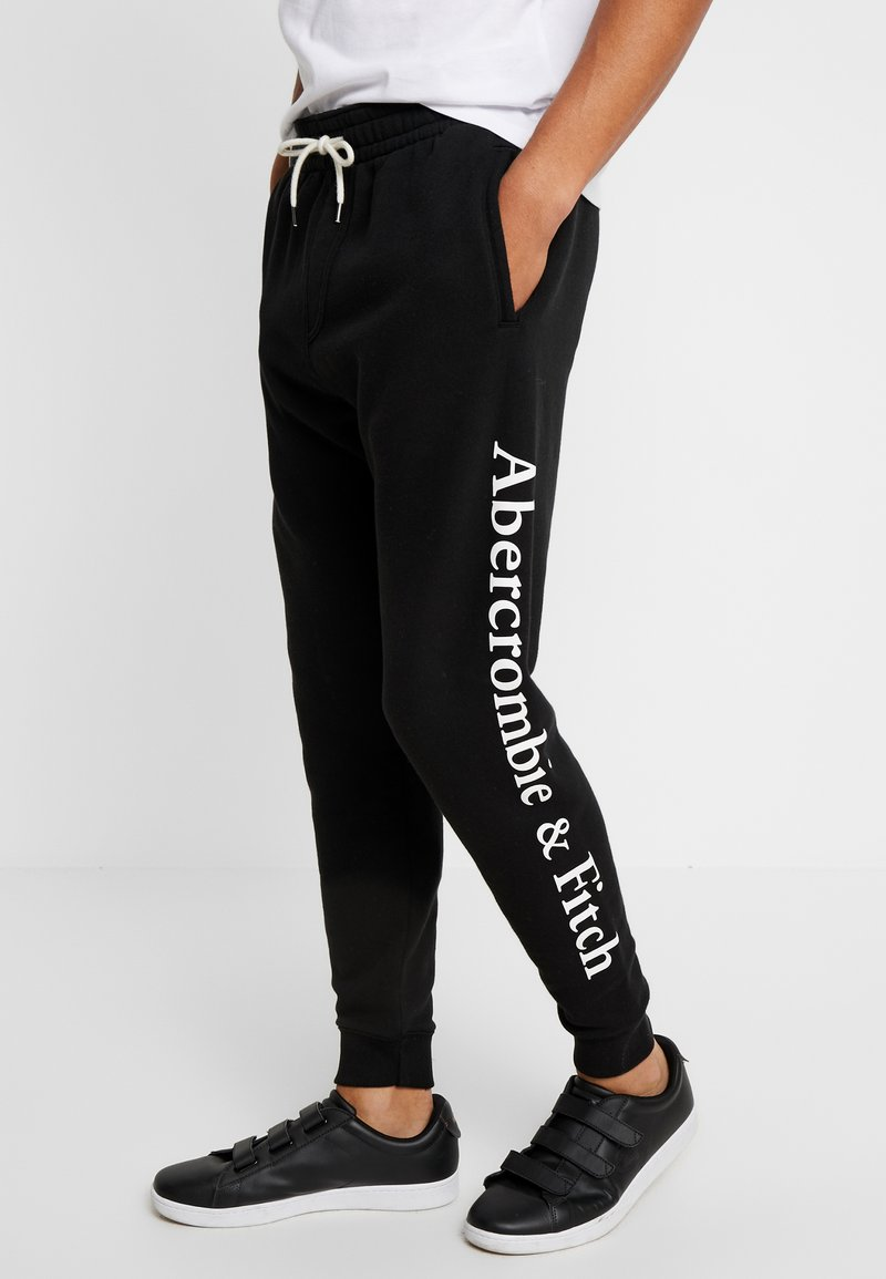 Abercrombie & Fitch - COREWEIGHT LOGO  - Tracksuit bottoms - black