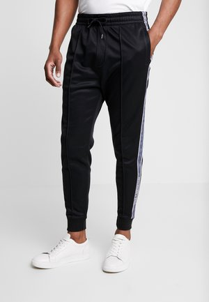 LOGO TAPE TRICOT - Tracksuit bottoms - black