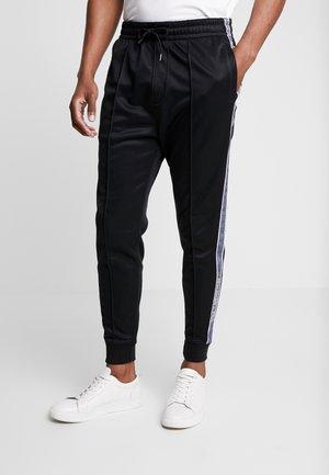 LOGO TAPE TRICOT - Teplákové kalhoty - black