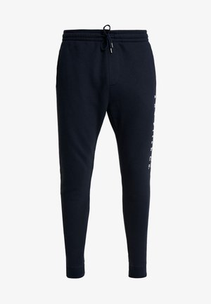 FLOCK TREND LOGO - Tracksuit bottoms - navy