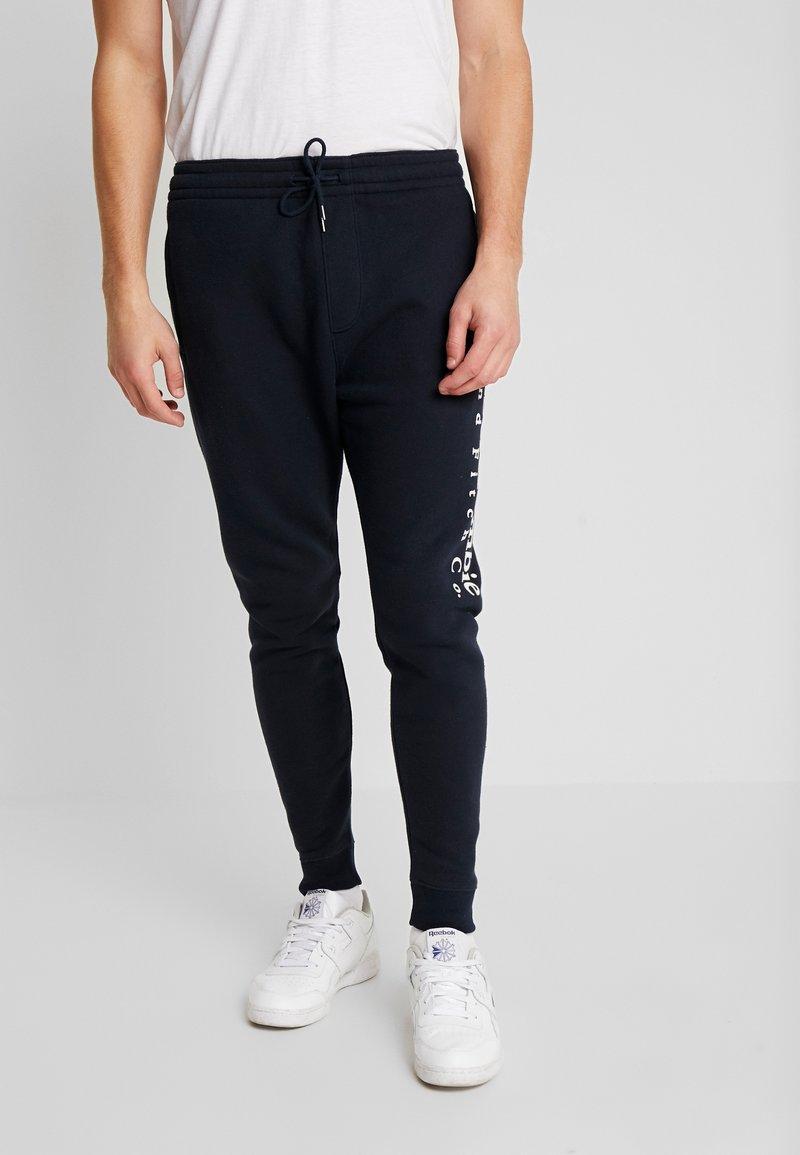 Abercrombie & Fitch - FLOCK TREND LOGO - Teplákové kalhoty - navy