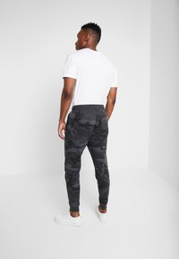 Abercrombie & Fitch - ICON JOGGER  - Tracksuit bottoms - black - 2