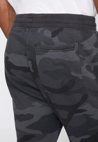 Abercrombie & Fitch - ICON JOGGER  - Tracksuit bottoms - black - 5