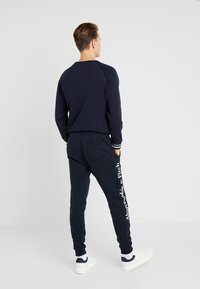 Abercrombie & Fitch - ICON JOGGER - Tracksuit bottoms - navy/sky captain - 2