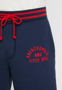 Abercrombie & Fitch - TIPPED APPLIQUE LOGO  - Tracksuit bottoms - navy - 4