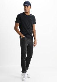 Abercrombie & Fitch - POP ICON CREW - Basic T-shirt - black - 1