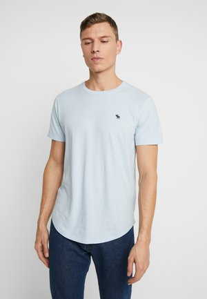 CURVED HEM ICON - Triko s potiskem - light blue